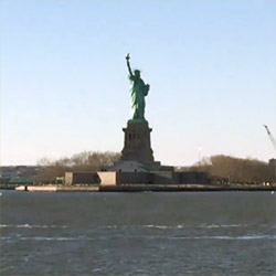 Riding on the Staten Island Ferry past the Statue of Liberty National Monument